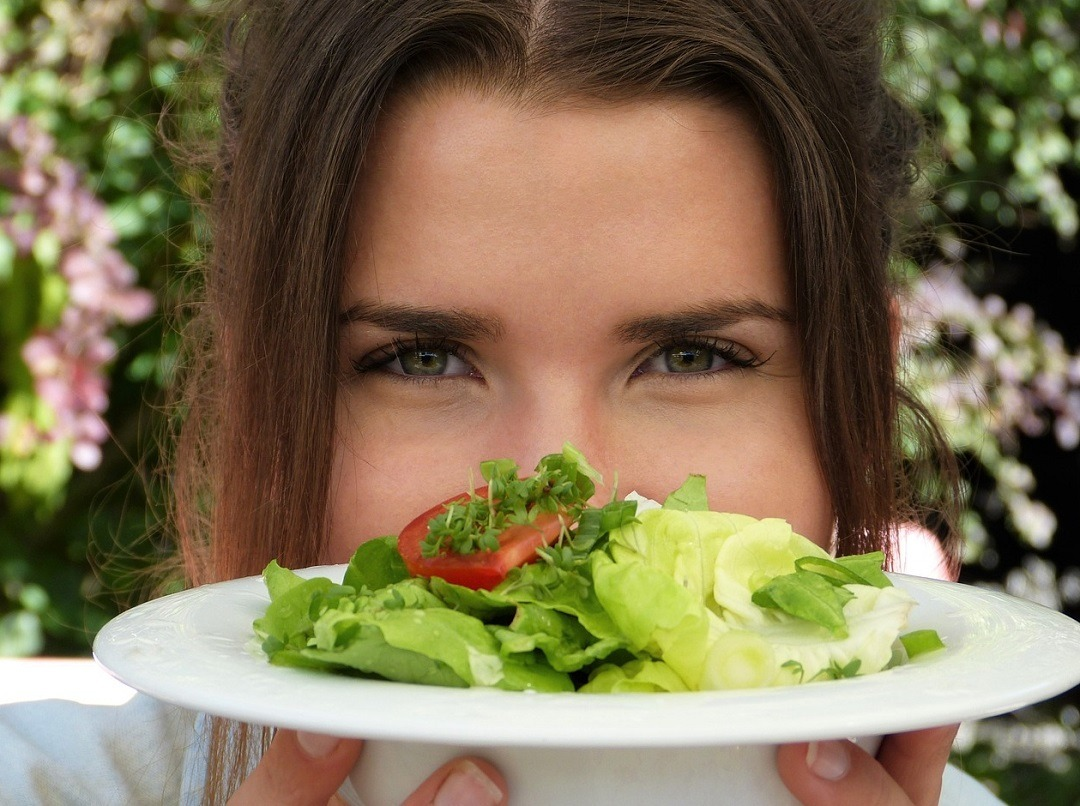 Girl Holding Plate With Salad